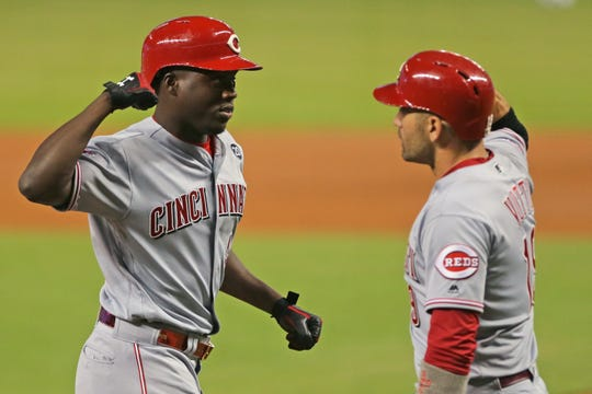 Aug 29, 2019; Miami, FL, USA; Cincinnati Reds right fielder Aristides Aquino (44) celebrates with first baseman Joey Votto (19) after hitting a two run home run in the first inning of the game against the Miami Marlins at Marlins Park.