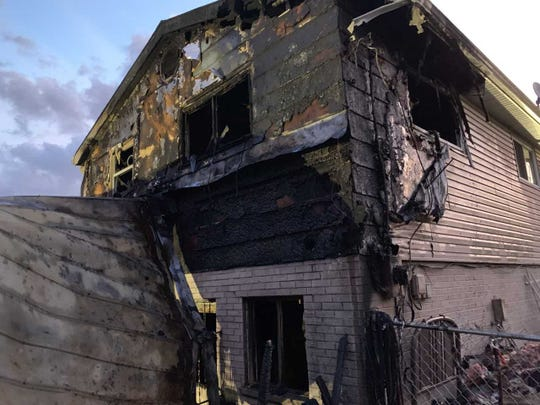 """It's just a house,"" said William Robinson, one of four who escaped safely from the fire."