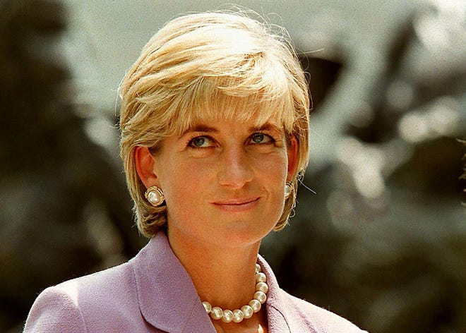 This file photo taken on June 17, 1997 shows Britain's Diana, Princess of Wales, at a ceremony at Red Cross headquarters in Washington.