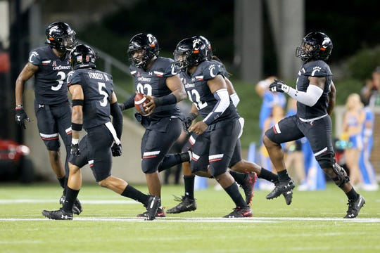 Cincinnati Bearcats defensive tackle Curtis Brooks (92) runs back to the sideline after a fumble recovery in the fourth quarter of an NCAA football game against the UCLA Bruins, Thursday, Aug. 29, 2019, at Nippert Stadium in Cincinnati. Cincinnati won 24-14.