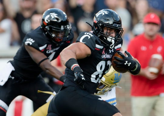 Cincinnati Bearcats tight end Josiah Deguara (83) scores a touchdown in the first half of the NCAA football game between Cincinnati Bearcats and UCLA Bruins on Thursday, Aug. 29, 2019, at Nippert Stadium in Cincinnati. Cincinnati Bearcats defeated UCLA Bruins 24-14.