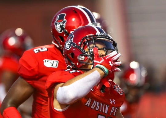 Austin Peay's DeAngelo Wilson (11) blows a kiss to the crowd after a touchdown during the season opener football game for Austin Peay at Fortera Stadium in Clarksville, Tenn., on Thursday, Aug. 29, 2019.