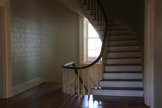 A staircase on the second floor of the Robb-Hayes House, which is being renovated by Austin Peay State University, leads up to an attic.