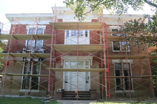 Workers have begun doing masonry work on the Robb-Hayes House, which stands shrouded in scaffolding on Aug. 30, 2019, as renovation work by Austin Peay State University gets underway.