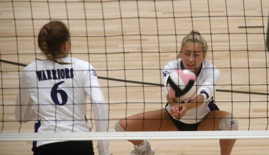 Norwalk's Grace Sutcliffe digs the ball. Norwalk beat Des Moines Lincoln 25-16, 24-26 and 15-9 in an Aug. 29 tournament at Southeast Polk High School.