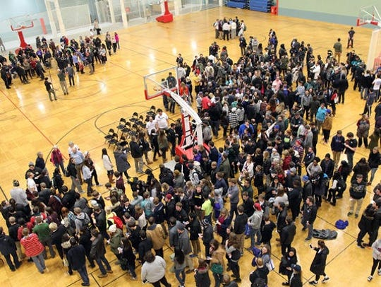 Democratic caucusgoers divide into groups at the University of Iowa Field House on Monday, Feb. 1, 2016.