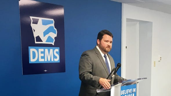 """Iowa Democratic Party Chairman Troy Price speaks at Des Moines' Iowa Democratic Party headquarters on Aug. 30. """"Iowa will be a caucus. And Iowa will be first,"""" Price maintained."""