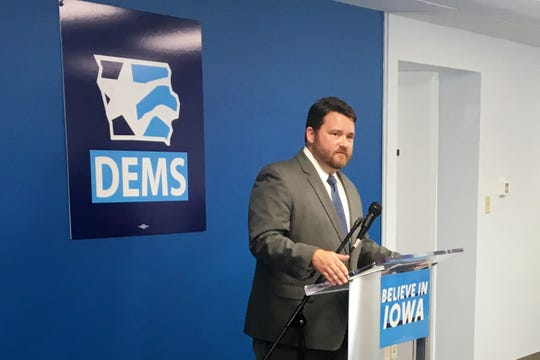 "Iowa Democratic Party Chairman Troy Price speaks at Des Moines' Iowa Democratic Party headquarters on Aug. 30. ""Iowa will be a caucus. And Iowa will be first,"" Price maintained."