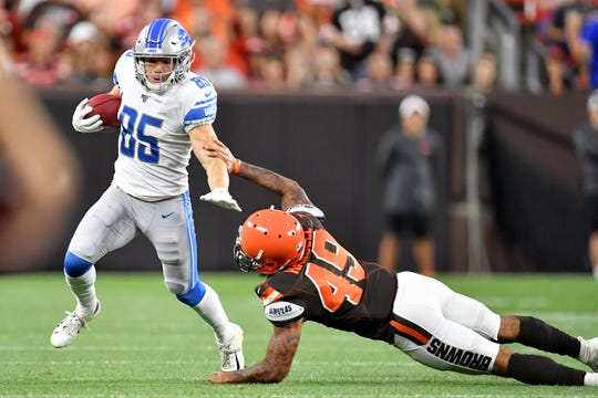 Lions wide receiver Tom Kennedy returns a punt while under pressure from defensive back J.T. Hassell during the first half of the Lions' 20-16 preseason loss to the Browns on Thursday, Aug. 29, 2019, in Cleveland.