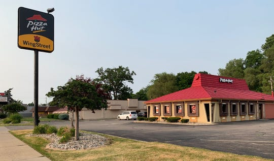 This Pizza Hut kept the classic red roof on North Wayne Road. Captured on July 8.