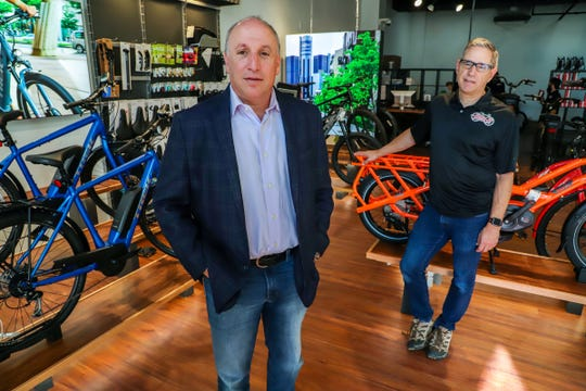 Richard Broder, CEO of Border & Sachse Real Estate talks about the new storefront at Orchestra Place, Electric Ave Bikes, with the owner Michael Reuter in Midtown Detroit, photographed on Thursday, Aug. 29, 2019.