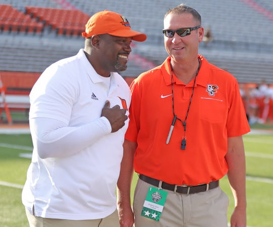 Morgan State coach Tyrone Wheatley and Bowling Green coach Scot Loeffler meet up before their game Aug. 29, 2019 at Doyt L. Perry Stadium in Bowling Green, Ohio.
