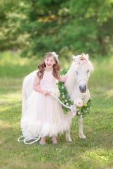 Maddox McClintic of Alpena, Mich. poses during a unicorn photo shoot in July 2018. McClintic's photo will appear in a video in Times Square before the National Down Syndrome Society's 2019 Buddy Walk.