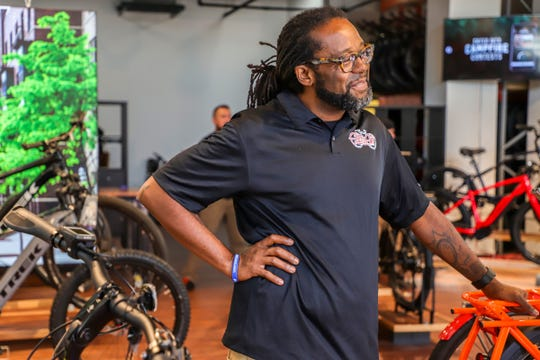 Jason Hall, co-founder of Slow Roll Detroit, was initially skeptical but quickly came to love e-bikes. He now does sales and bike tours at Electric Avenue Bikes in Midtown Detroit.