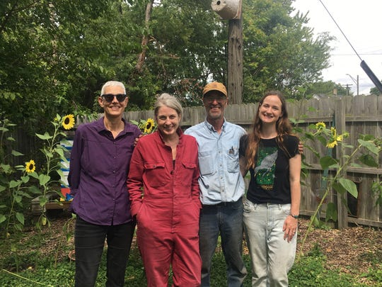 From left to right: Diane Cheklich, the director and chair of Detroit Audubon's conservation committee, Detroit residents Monica Breen and Paul Weertz and Detroit Audubon Research Associate Ava Landgraf. The four stand in the backyard of Breen's and Weertz's duplex on Tuesday, Aug. 27, 2019.