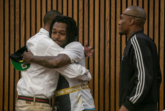 James Clay hugs his little brother Jeremy Lyons as his best friend Robert L. Wilson after Clay appeared in Wayne County Circuit Court Friday, Aug. 30, 2019. The rape case against him was dismissed during the hearing. New evidence cast doubt that Clay sexually assaulted a 15-year-old in 1997. Clay has maintained he is innocent. He was released from prison July 23, 2019.