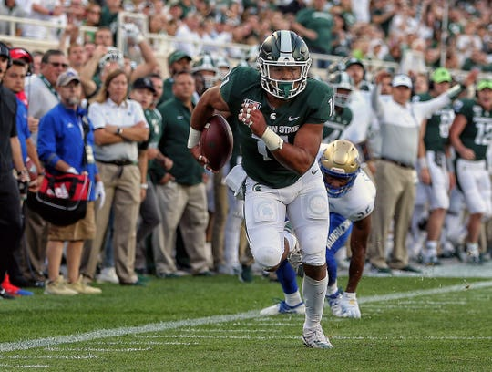 Michigan State's Connor Heyward runs toward the end zone during the first quarter against Tulsa at Spartan Stadium, Aug. 30, 2019.