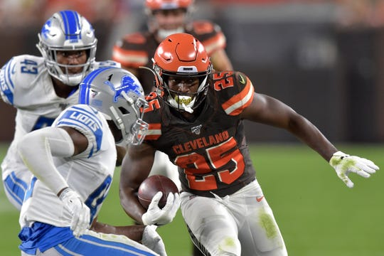 Cleveland Browns running back Dontrell Hilliard (25) runs for a first down during the first half of the team's NFL preseason football game against the Detroit Lions, Thursday, Aug. 29, 2019, in Cleveland.