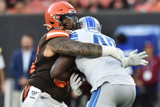 Cleveland Browns defensive tackle Daniel Ekuale (96) tackles Detroit Lions running back Mark Thompson (49) during the first quarter at FirstEnergy Stadium, Thursday, Aug. 29, 2019, in Cleveland.