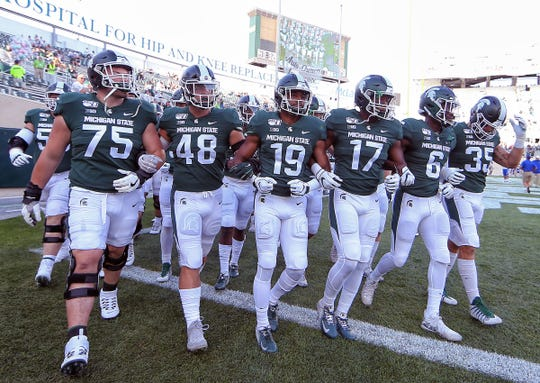 The Michigan State Spartans players take the field prior to their game against the Tulsa Golden Hurricane at Spartan Stadium, Aug. 30, 2019.