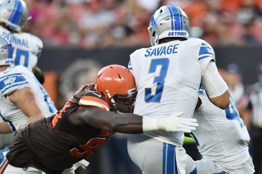 Cleveland Browns defensive tackle Devaroe Lawrence (99) sacks Detroit Lions quarterback Tom Savage (3) during the first quarter at FirstEnergy Stadium, Thursday, Aug. 29, 2019, in Cleveland.