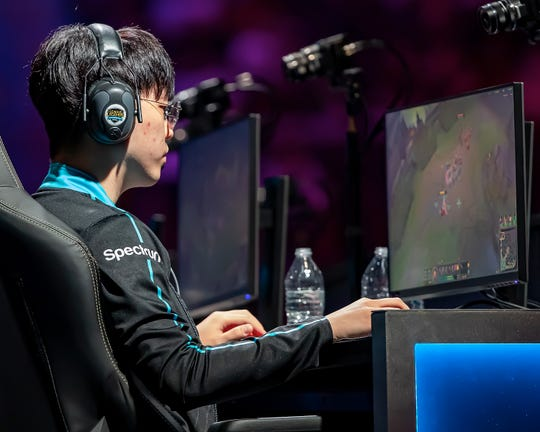 "Vincent ""Biofrost"" Wang of Team Counter Logic Gaming works his controls as he watches his screen during Day 1 of the  2019 LCS Summer Finals at Little Caesars Arena on Aug. 24."