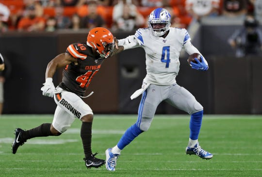 Detroit Lions quarterback Josh Johnson (4) rushes against Cleveland Browns defensive back Tigie Sankoh (40) during the second half.