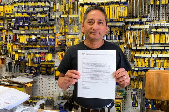 In this photo taken Wednesday, Aug. 28, 2019, Albert Chow, owner of Great Wall Hardware in San Francisco, holds a May 2019 letter from a supplier notifying him that prices will be increasing 10 to 18 percent because of US tariffs on Chinese goods. He says he has no choice but to raise store prices on those products.