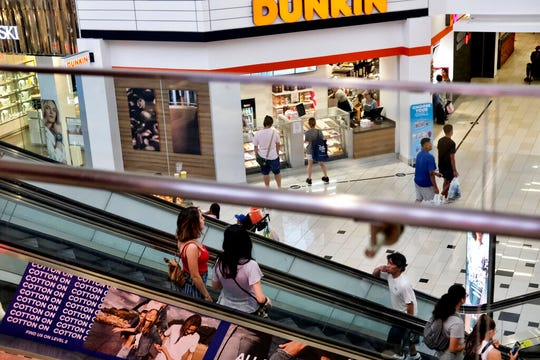 In this Aug. 7, 2019, file photo shoppers ride an escalator inside the Glendale Galleria in Glendale, Calif. The University of Michigan's final sentiment index fell to 89.8 in August from a previously reported 92.1 and 98.4 in July showing the lowest level of consumer sentiment since 2012.