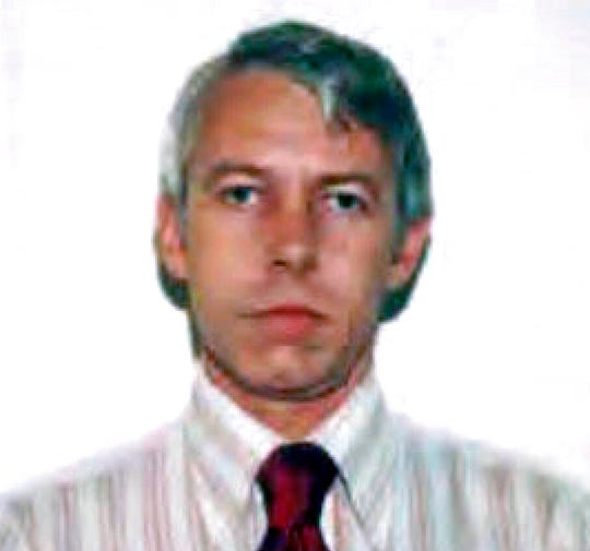 This undated file photo shows a photo of Dr. Richard Strauss, an Ohio State University team doctor employed by the school from 1978 until his 1998 retirement.