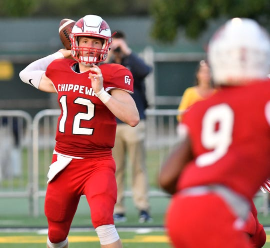 Chippewa Valley quarterback Josh Kulka passes during the first half of Thursday's win over Saline at the Xenith Prep Kickoff Classic at Wayne State.