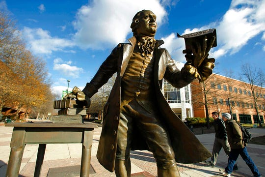 """In this Tuesday, Dec 14, 2010 file photo, a statue of George Mason stands in the heart of George Mason University's Fairfax campus in Fairfax, Va.  Newly released documents show that a $50 million gift to Virginia's largest public university was given specifically to """"promote the conservative principles of governance,"""" raising concerns from critics that that it compromises academic freedom."""