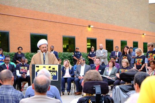 Imam Mohammad Ali Elahi, the spiritual leader of the Islamic House of Wisdom, speaks to the crowd at the University of Michigan - Dearborn for a Take On Hate event on Aug. 29, 2019.