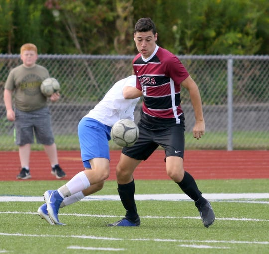 Noah Sperduto (19) of Elmira tries to control the ball as Riley Schwab of Horseheads defends him during the Express' 2-0 win in boys soccer Aug. 30, 2019 at Ernie Davis Academy.