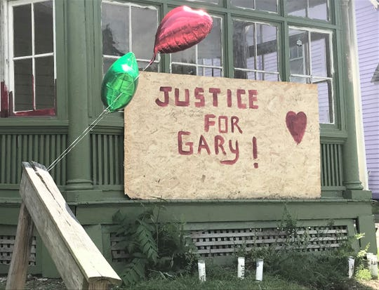 A memorial was created outside the house on Horner Street in Elmira where Gary Strobridge lived. Strobridge died following his arrest last week by Elmira police officers.