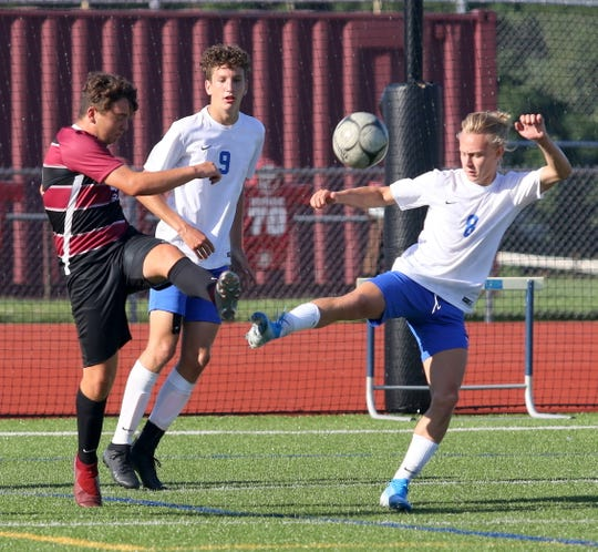 Talon Wise, left, of Elmira and Owen Foster (8) of Horseheads go for the ball in front of Horseheads' Kevin Reasons (9) during the Express' 2-0 win in boys soccer Aug. 30, 2019 at Ernie Davis Academy.