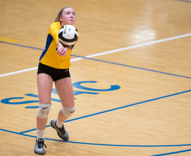Castle's Keira Moore (40) sets the ball during the Castle Lady Knights vs Reitz Lady Panthers game Thursday evening, Aug. 29, 2019.