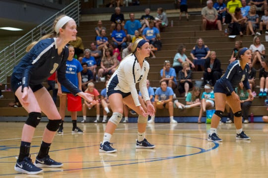 Reitz's Lily Beyers (3), Reitz's Caycee Small (6) and Reitz's Victoria Garland (2) anticipate the ball during the Castle Lady Knights vs Reitz Lady Panthers game Thursday evening, Aug. 29, 2019.