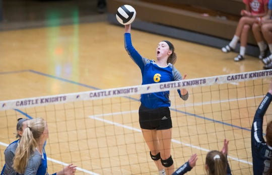 Castle's Carly Harpenau  spikes the ball during the Castle Lady Knights vs Reitz Lady Panthers game Thursday evening, Aug. 29, 2019.