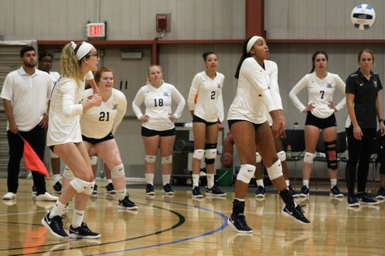 Terra State Community College volleyball player Leticia Netters-Harbolt returns a serve Thursday in the Titan's 2019 home opener against Clark State Community College. Terra State pulled off a five-set comeback win to improve to 1-1.