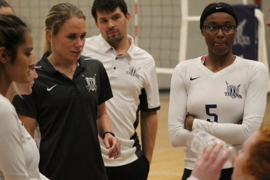 Terra State Community College head women's volleyball coach Stephanie Champine, flanked by assistant coach Shaun Dryden, talks to players during a timeout Thursday at the team's home opener. Terra State beat Clark State Community College in five sets to improve to 1-1.