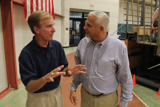 Current Terra State Community College athletic director Jerry Buccilla, right, talks to former Terra State athletic director Denny Kayden Thursday before the start of the 2019 home opener for the Titans' volleyball team.