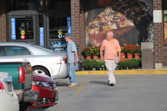 Shoppers leave Fifth Street Kroger with bags of groceries, or sometimes with a newspaper as the location on Fremont' east side has become a popular stop for many residents who living within walking distance of the store.