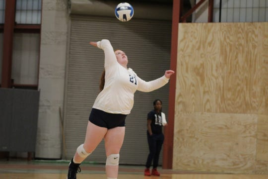 Terra State Community College volleyball player Alyson Goeken serves Thursday during the Titans' match against visiting Clark State Community College. The Titans won the match in five sets.