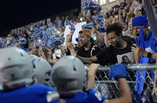 Poudre High School students cheer with the Poudre football players after the victory over Arvada West High School at J. Ray French Field in Fort Collins, Colo. on Thursday, Aug. 29, 2019.