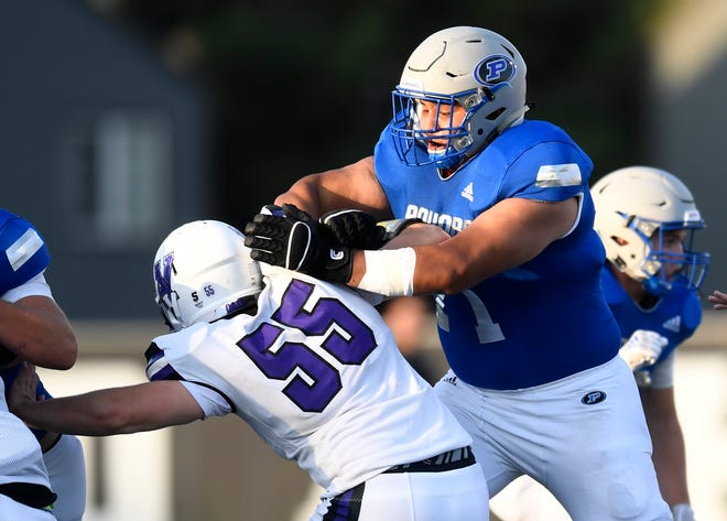 Poudre's Brian Crespo (71) blocks Arvada West's Elijah Olson (55) in the second quarter of the game at J. Ray French Field in Fort Collins, Colo. on Thursday, Aug. 29, 2019.