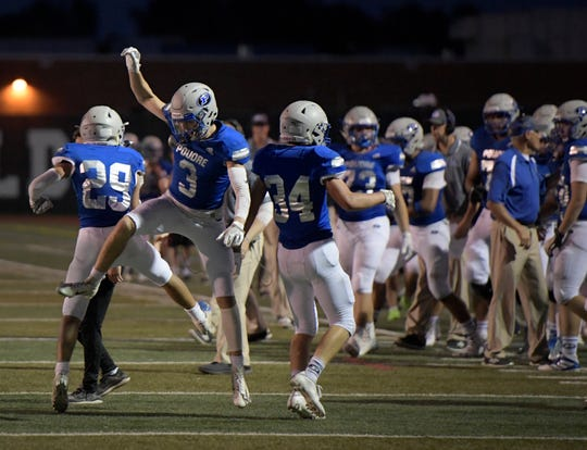 Poudre High School football players celebrate a fourth-down stop in a win over Arvada West on Aug. 29, 2019. The Impalas host Cherokee Trail at 7 p.m. Friday at French Field.