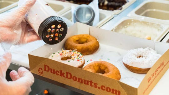 Duck Donuts fries and tops its doughnuts to order.