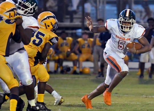 Dunbar High School Jadarius Green-McKnight (5) runs the ball during their game with Lehigh High School in  Lehigh, Thursday, Aug. 29, 2019.