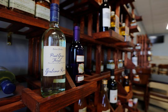 An array of wines line a wall at Mirone's Italian Hoagies in Cape Coral.